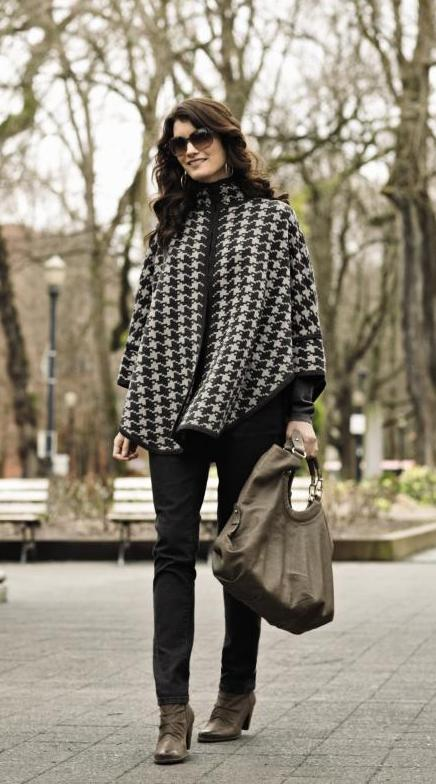 Woman in black and white houndstooth Pendleton cape