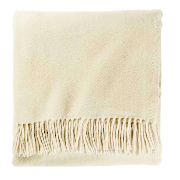 A lovely white herringbone fringed throw by Pendleton.