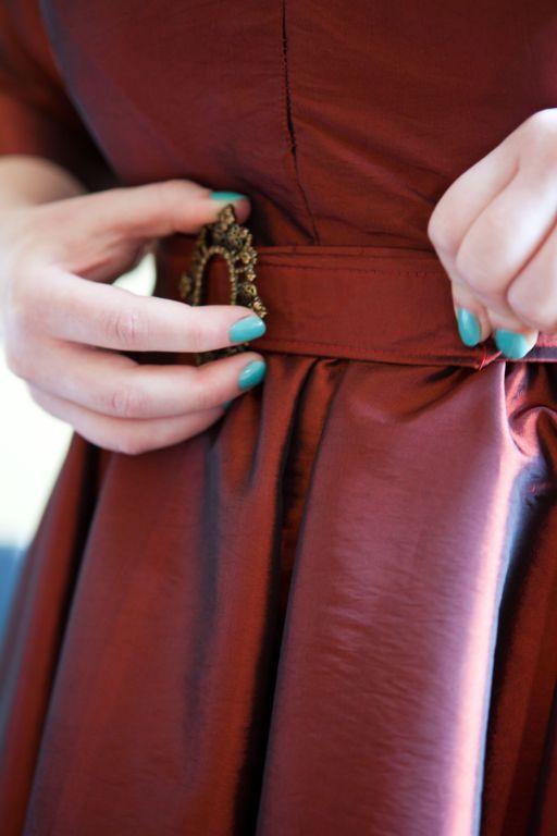 Buckle detail, and nail polish