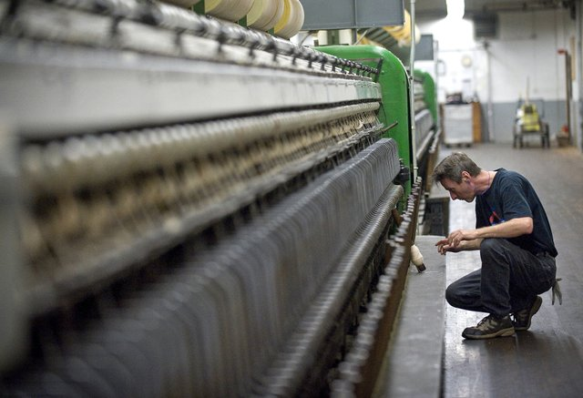 A man works on the Washougal loom. Photo courtesy The Columbian