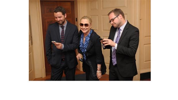 Hillary Clinton wearing a Pendleton ruffled blouse.