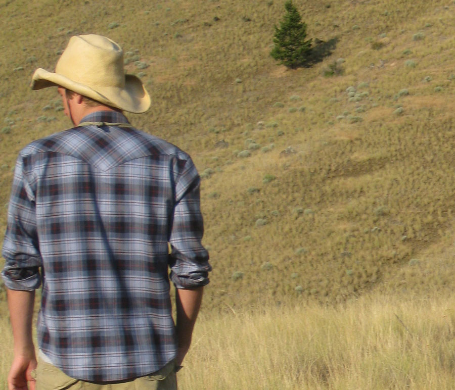 A man in a Pendleton Fitted shirt in the hills of Idaho