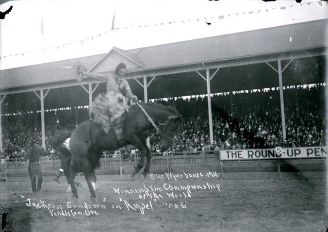 "A rare photo of Jackson Sundown riding in the Pendleton Round-Up Arena. The photo has been written upon, and these are the words: ""Moorhouse 1916 - Winning the Championship of the World 'Jackson Sundown' on 'Angel' 'no 6' Pendleton Ore"""