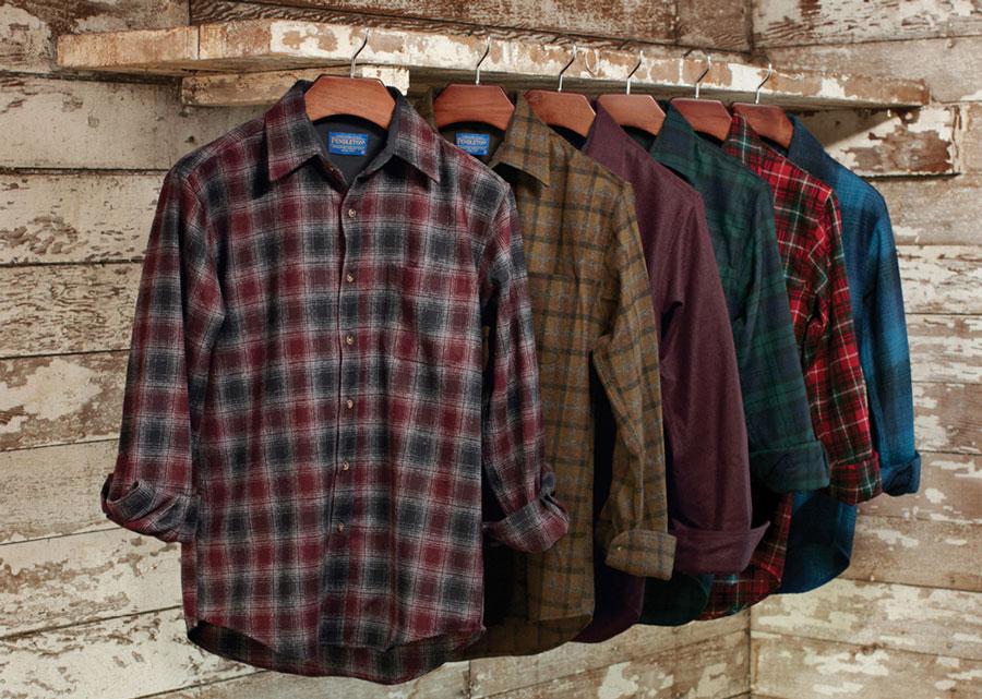 Wool Pendleton shirts hanging on a rustic shelf