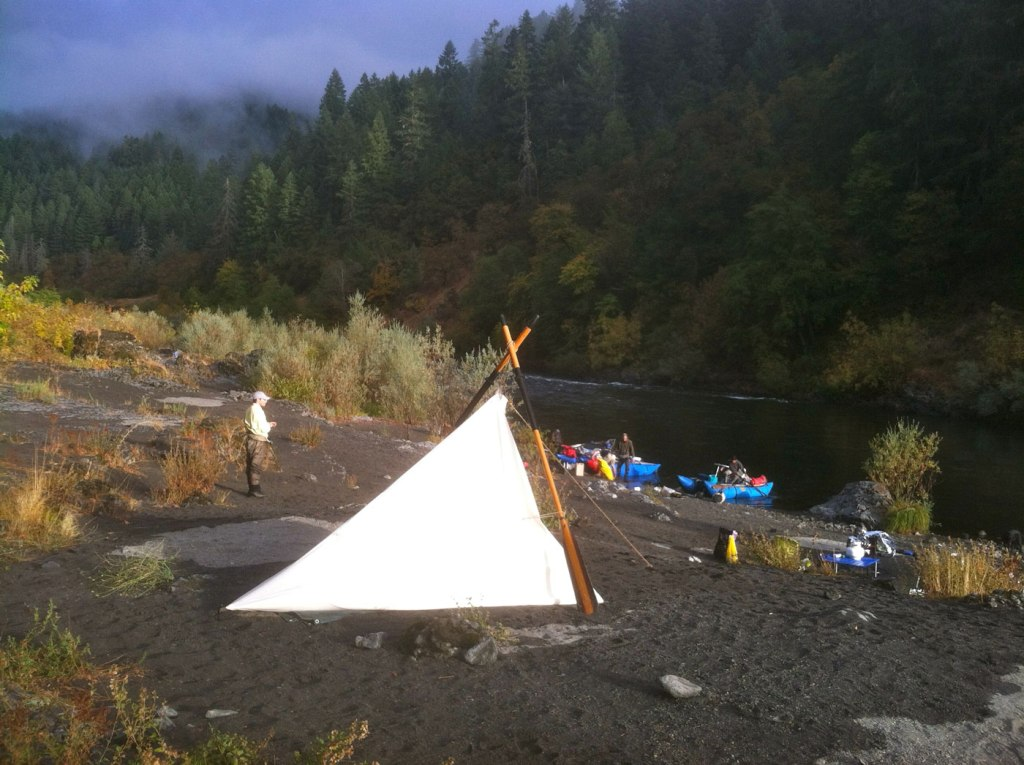 Camping in a canvas tent on the banks of the Rogue River