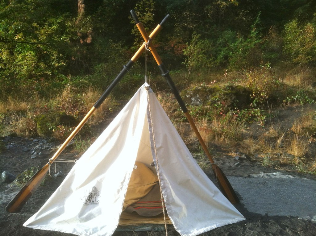 Canvas tent, the bedroll has a Pendleton Yakima Camp blanket