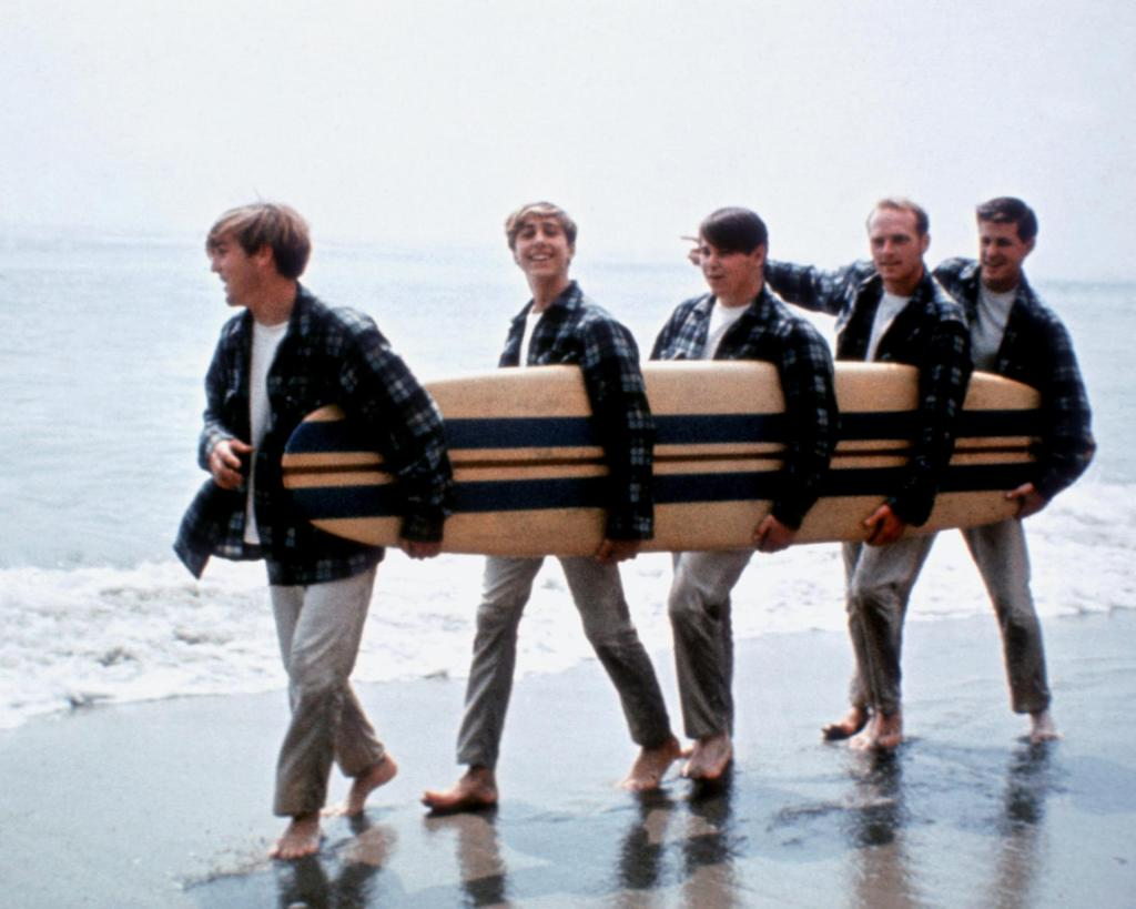 The Beach Boys in their Board Shirts on the beach