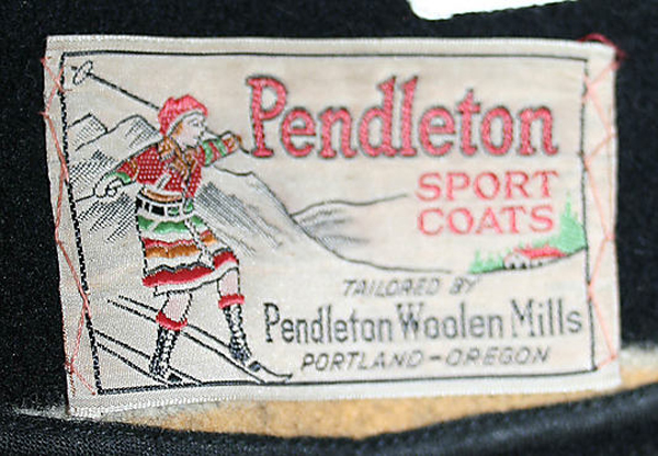 Woven label with woman skiing