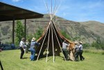 Jackson Sundown's tipi is raised by volunteers.