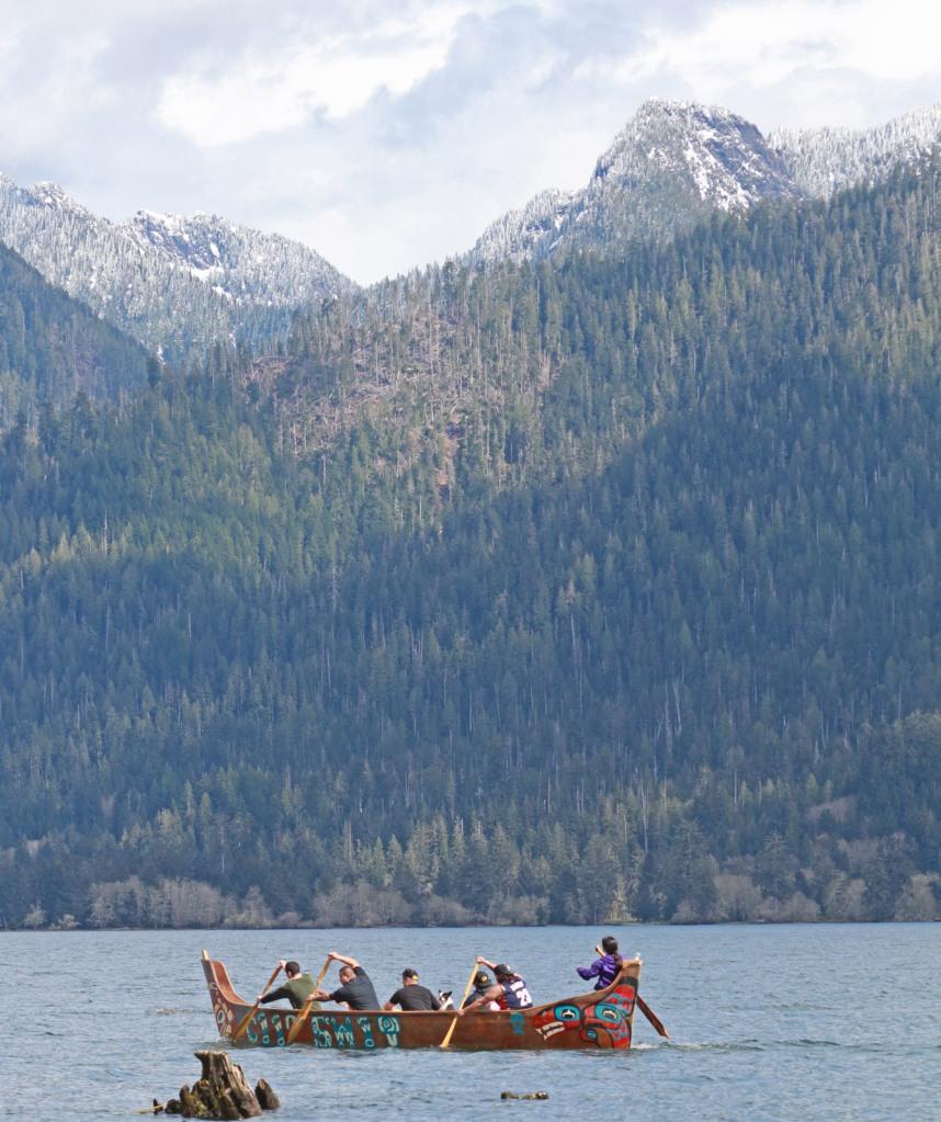 Native boaters paddle the Salish Sea