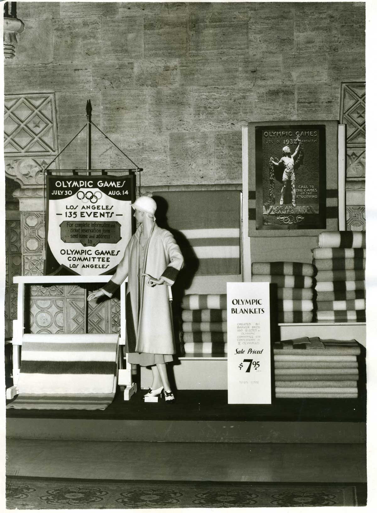 A display with striped blankets and some outerwear honoring the 1932 Olympic games in Los Angeles