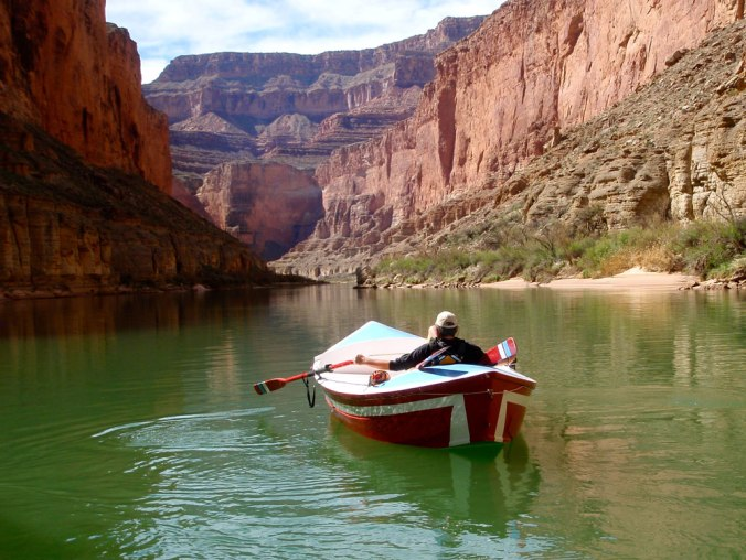 Greg Hatten in the Portola, on still green waters of the Colorado River.