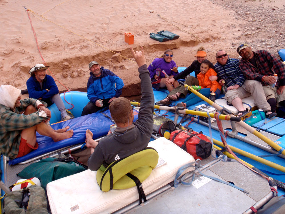Relaxing at the river's edge: Greg Hatten and eight more river runners relax after a day on the river.