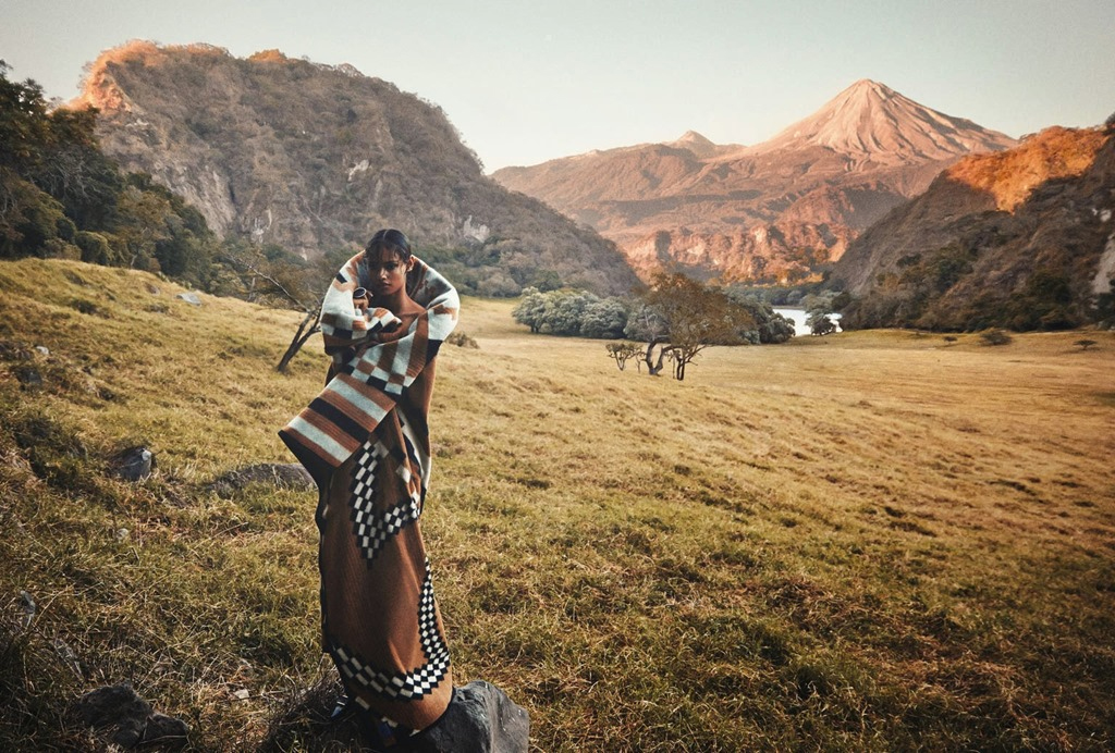 Porter shot of model in the mountains wrapped in a basket Dance blanket