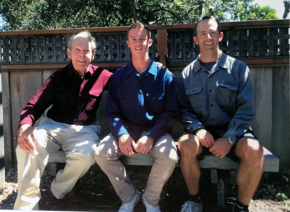 Three generation of men from the Smith family in their Pendleton shirts.