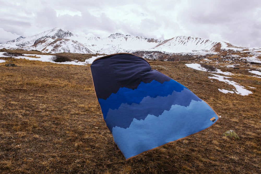 pendleton_hunterlawrence-copyright 2104  A blanket held by a person flutters in the wind