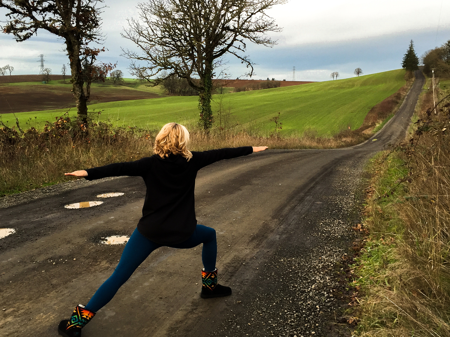 Amy Patterson doing a yoga pose on an Oregon road