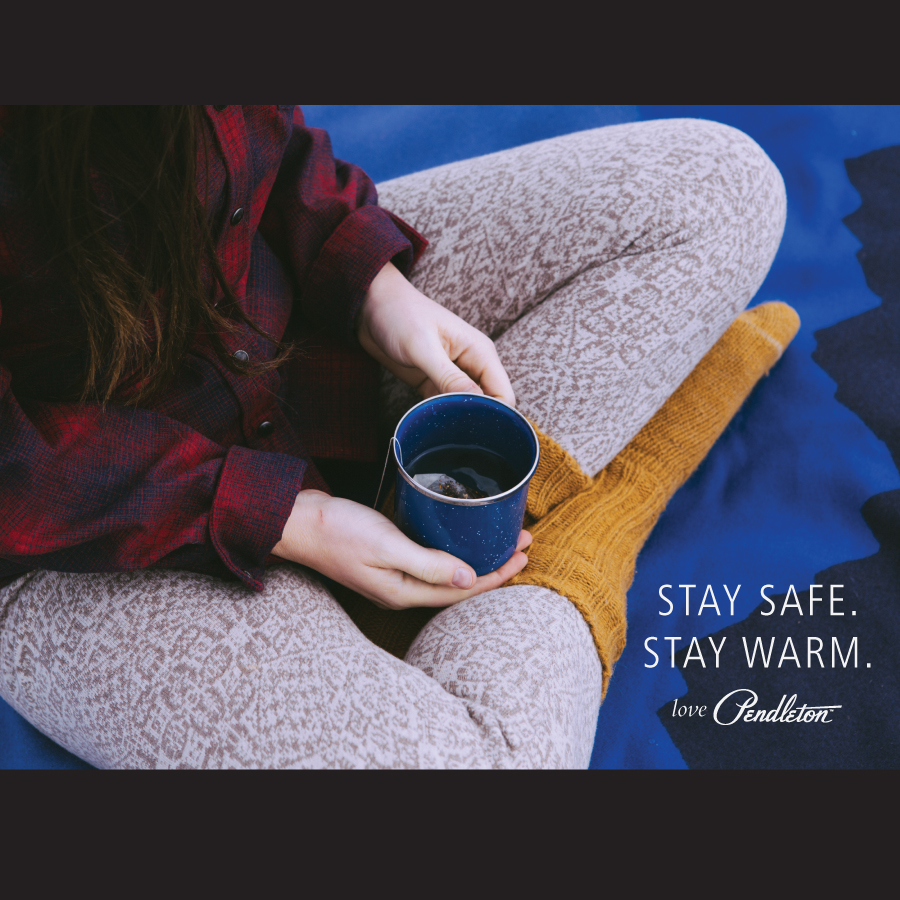 Social_Stay Warm; a woman with a cup of coffee sits crosslegged.