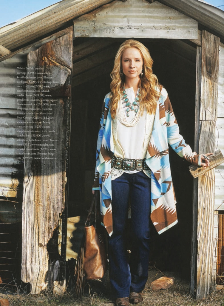 Cowboys & Indians Spring fashion shoot - Model stands by barn
