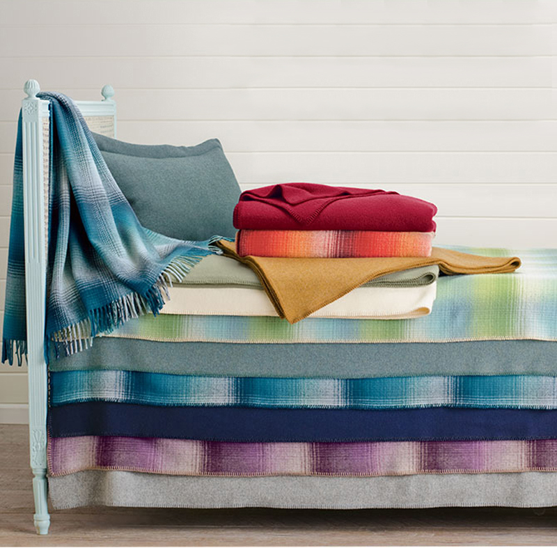 A bed with layered Eco-wise wool bed blankets