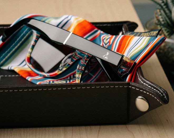 A pair of Shwood x pendleton sunglasses in a leather try