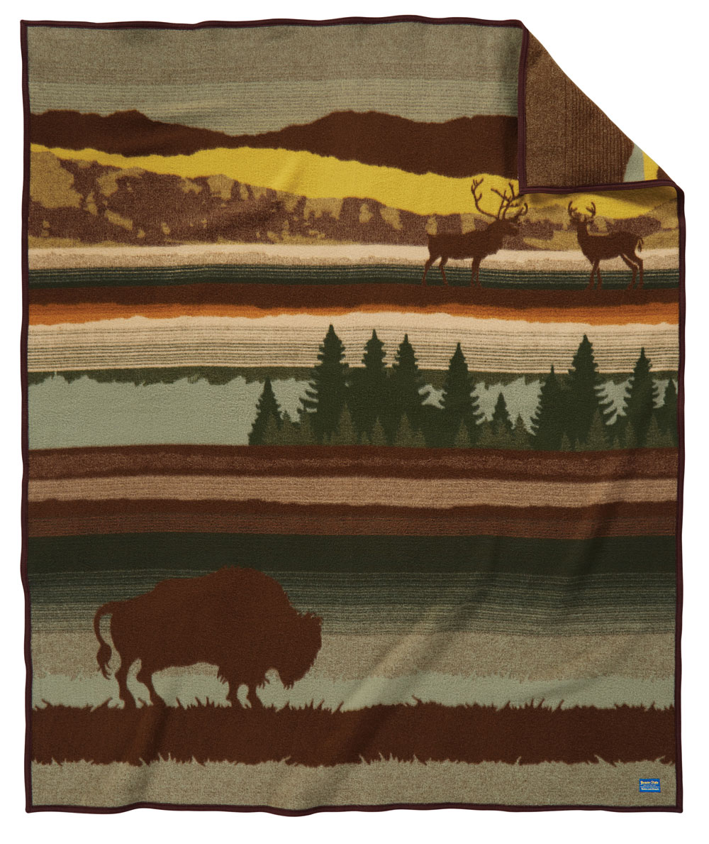 The Buffalo Wilderness blanket, by Pendleton, featuring a silhouette of a Bison on a landscape background.