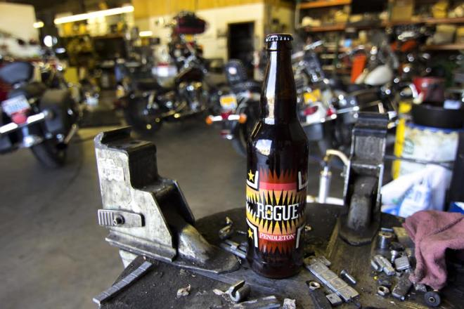 Pendleton x Rogue Ales collaboration beer on workbench in bike shop