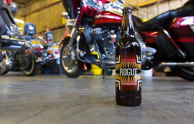 Pendleton x Rogue Ales collaboration beer in front of some very cool bikes