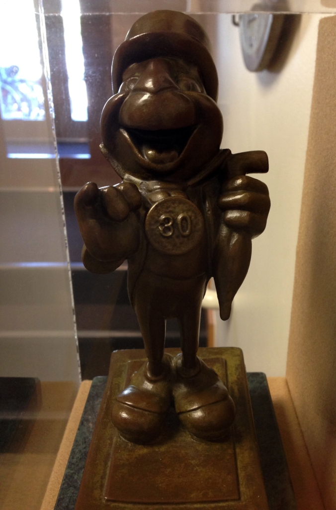 A small bronze statue of Jiminy Circket, given to Pendleton Woolen Mills to mark 30 years of association.