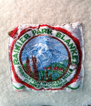 Photo of a blanket label for a Rainier National Park blanket from the 1940s.