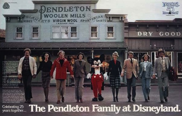 A line of models in the 1980s, posed in front of the Pendleton store in Frontierland. They are all wearing Pendleton clothing, and holding hands, with Mickey Mouse in the center of the line.