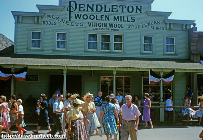 Disneyland guests outside the Pendleton Woolen Mills Dry Goods Emporium in Frontierland.