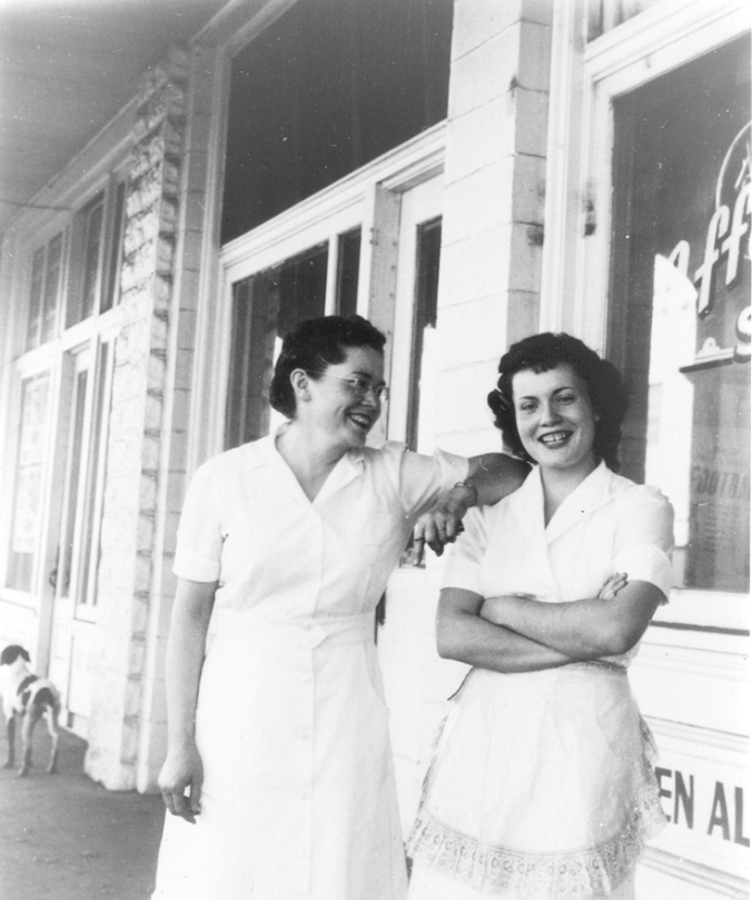 Wearing their waitress uniforms, Louise [left] and her daughter Wilma [right] in front of Louise's café.