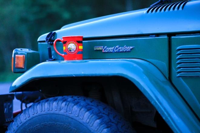 Rainier coffee cup on the fender of Greg's Toyota Land Cruiser