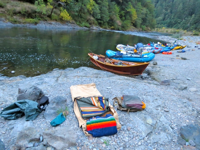 boats parked by riverbank, Greg's cot setup