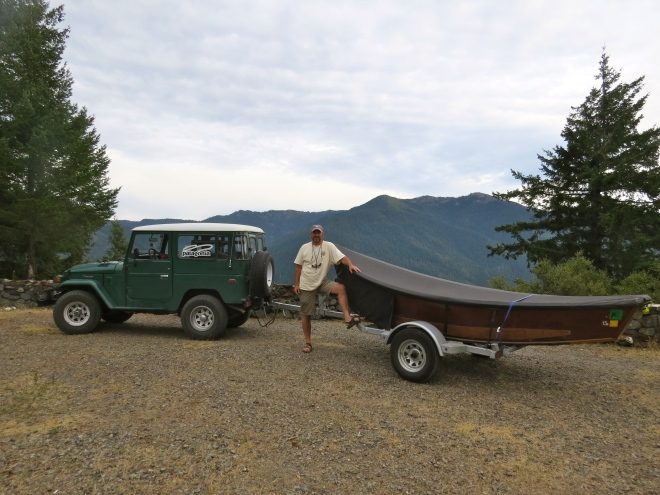 Greg hatten and his wooden boat, at the rim of the lake.
