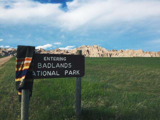 """A sign that says """"Entering Badlands National park"""""""