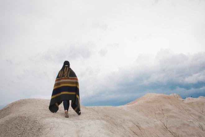 Woman walking on a rock