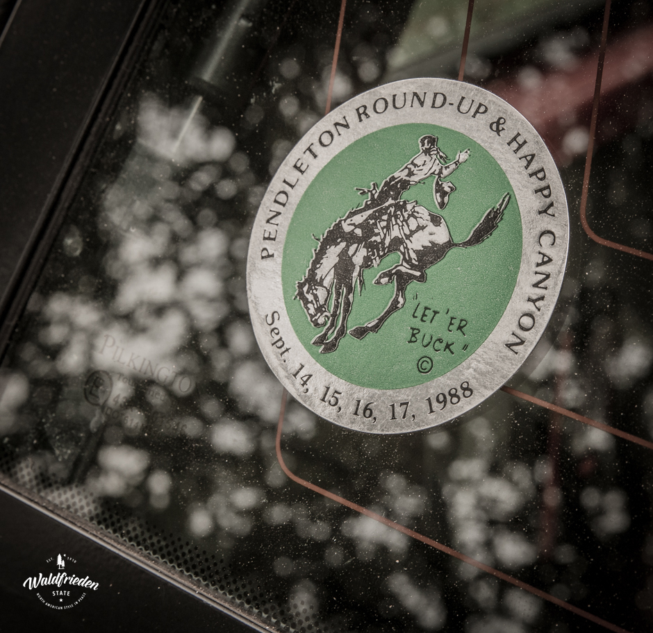 Vintage Round-Up sticker on a car window