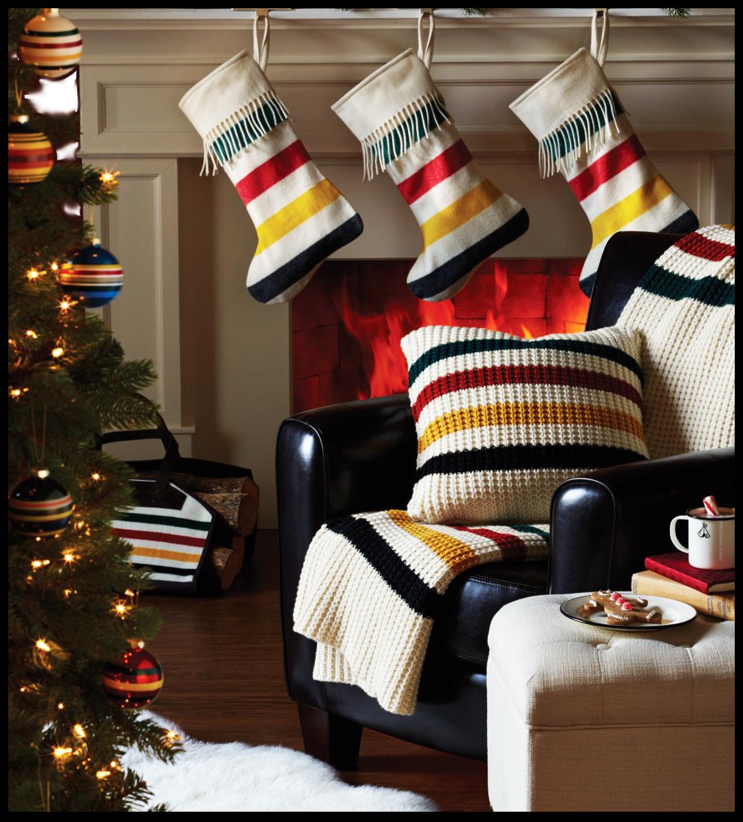 Pendleton Glacier National Park stripe Christmas goods by a fireplace