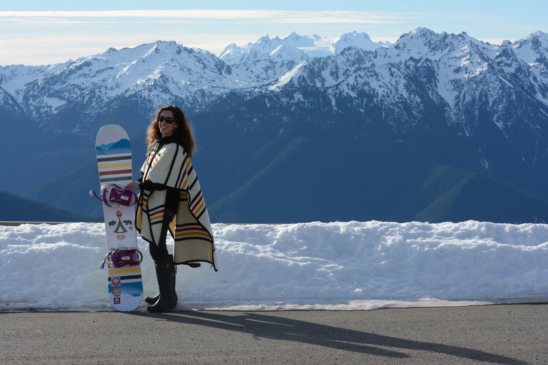 A professional women's snowboarder ar Glacier National Park.
