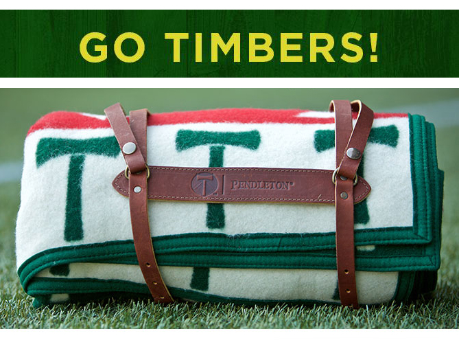 """Rolled blanket, with the words """"Go Timbers!"""""""