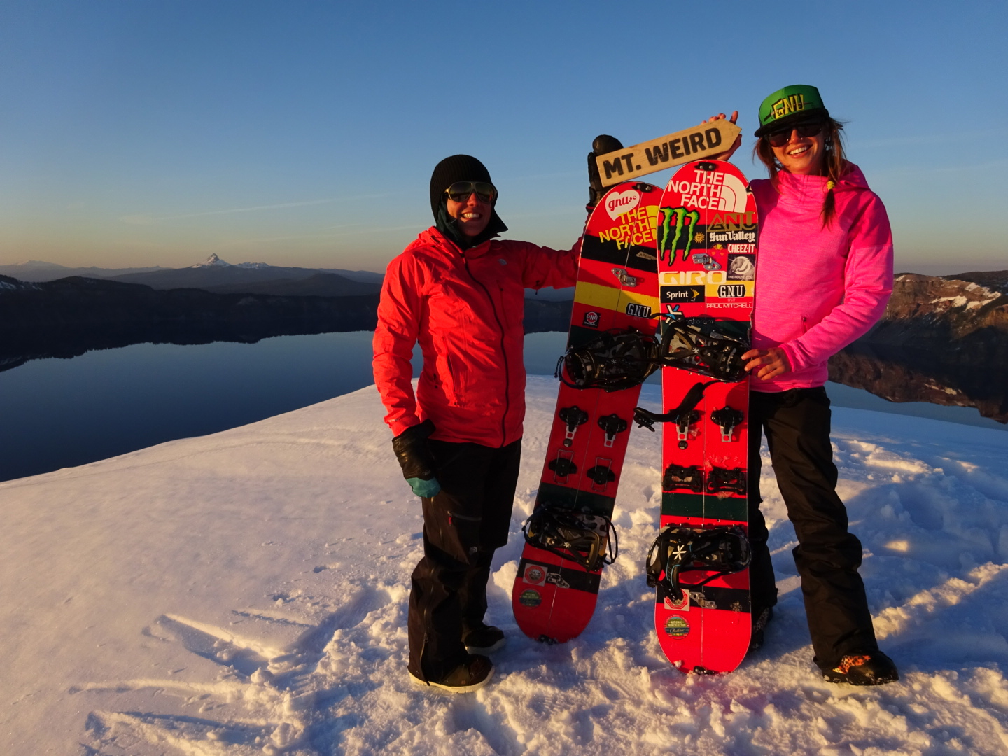 Professional women's snowboarders atop a mountain witht he GNU x pendleton boards