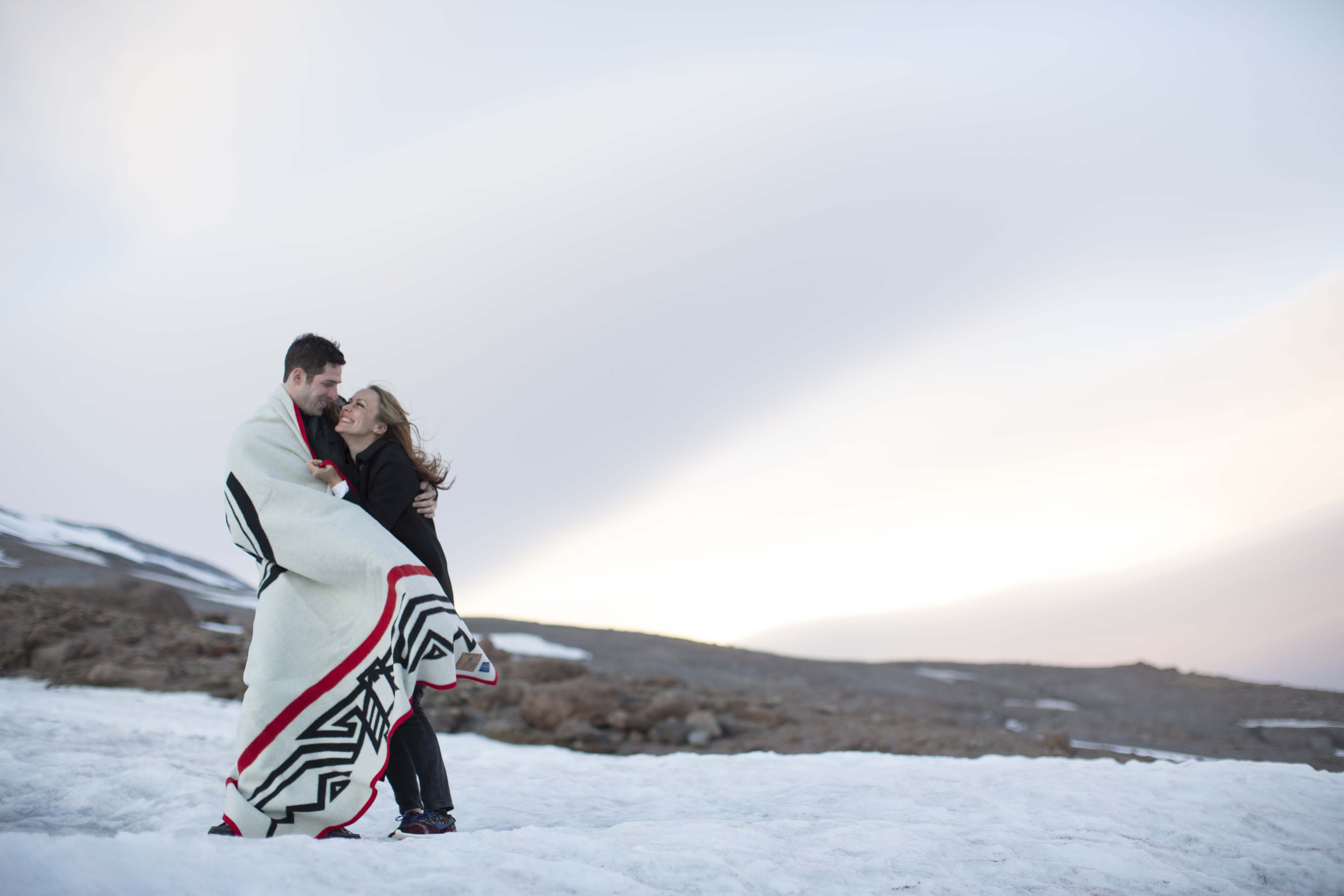 Sarah and Jeffrey on the snowy slopes of Mt Hood, wrapped in a Friends of Timberline blanket.