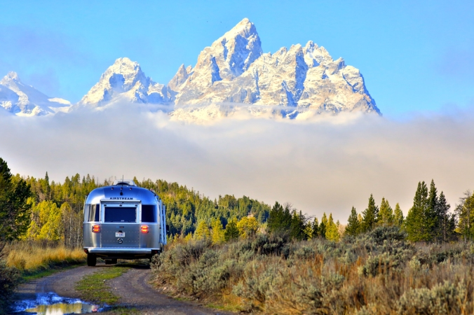 The rear of the Pendleton Airstream as it drives along a mountain road