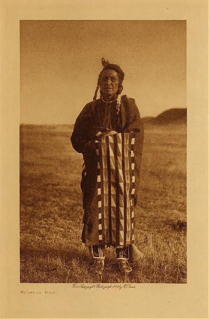 Hidatsa man by Edward Curtis. A Hidatsa man wrapped in one of the Racine blankets.