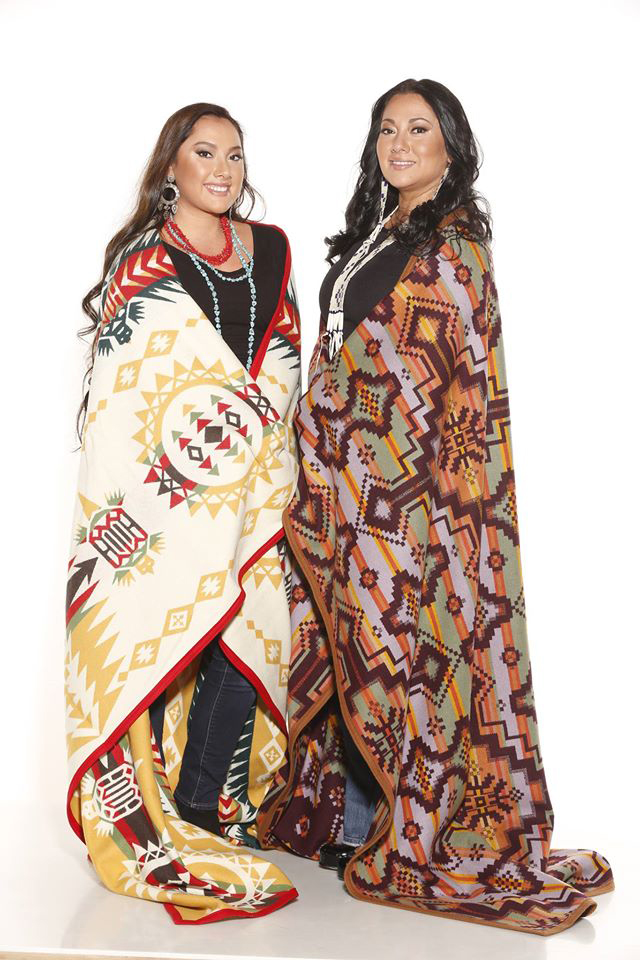 Mother and daughter wrapped in Pendleton blankets