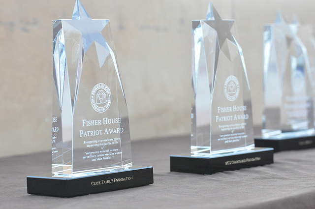 "Photo shows three crustal trophies given by the Fisher House Foundation as their ""Patriot Award"""