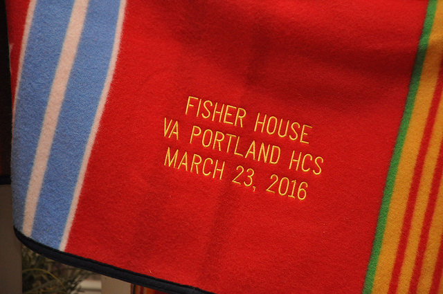 "A close shot of the embroidery on the Pendleton Grateful Nation blanket which reads ""FISHER HOUSE/VA PORTLAND HCS/MARCH 23, 2016"""