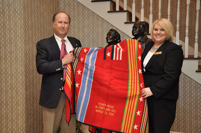 John Bishop, Pendleton CEO, presents a special, custom-embroidered Grateful Nation Pendleton blanket to the staff at this newest location.